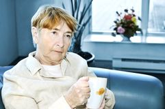 Sad elderly woman Royalty Free Stock Images
