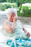 Sad elderly woman royalty free stock photos