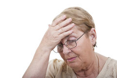 Sad elderly woman holding head Royalty Free Stock Photos