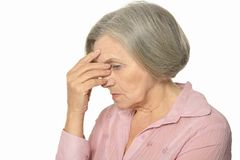 Sad elderly woman Stock Photos