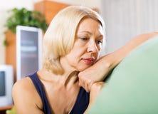Sad elderly woman Stock Image