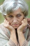 Sad eldery woman Royalty Free Stock Images