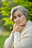 Sad eldery woman in park Royalty Free Stock Images