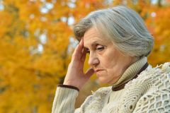 Sad eldery woman Stock Photo
