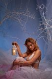 Sad elf woman with a lantern in a forest. Elf in magical winter forest with lantern Stock Photos