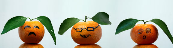 Sad, Embarrassing,surprise,. Oranges with leaves show us some faces Royalty Free Stock Photos