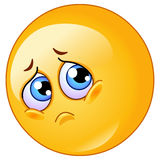 Sad emoticon. Cute emoticon making a sad face Stock Photography