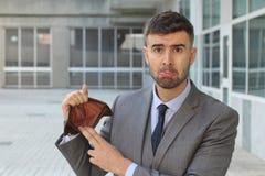 Sad entrepreneur with zero money royalty free stock photo