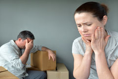 Sad evicted couple worried relocating house Stock Images
