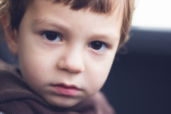 Sad eyes of a child. Sad, thoughtful and melancholic eyes of a young boy Stock Photography