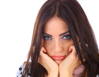 Sad Face. Young woman with a sad face and beautiful blue eyes royalty free stock photo
