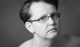 Sad face. Sad 50 year old woman, close-up black and white image Stock Photos