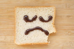 Sad face. Applied to the surface of the bread on the sad face Royalty Free Stock Image