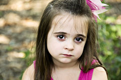 Sad Face. Beautiful brunette little girl posing with a sad facial expression Stock Photography