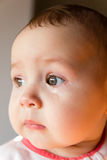 Sad face baby. A tear on the face Royalty Free Stock Image