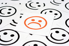 Sad face and happy faces Royalty Free Stock Photography