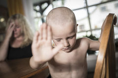 Sad face kid and hand raise to stop or protect Stock Photos
