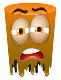 Sad face on orange tube Royalty Free Stock Image