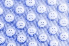 Sad face of pills. Negative side effects of drugs royalty free stock image