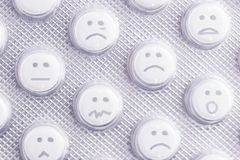 Sad face of pills. Negative side effects of drugs stock photography