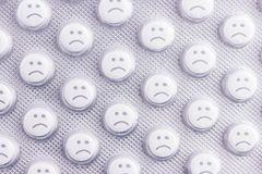 Sad face of pills. Negative side effects of drugs royalty free stock photography