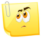 Sad face on yellow page Royalty Free Stock Image