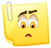 Sad face on yellow paper Stock Photos