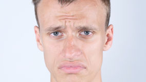 Sad face of young guy. Close Up of Man crying with tears. High quality Stock Images