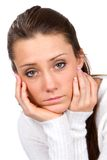 Sad Faced Woman. Sad faced young woman holds her face in her hands Stock Photo