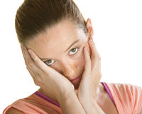 Sad Faced Woman. Sorry looking woman with face in hands over white Royalty Free Stock Photo