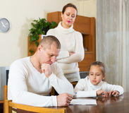 Sad family with documents Stock Photo