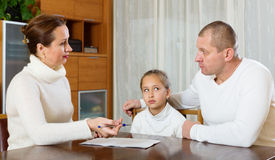 Sad family  with documents Royalty Free Stock Image