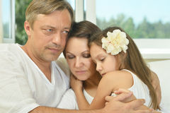 Sad family with girl Stock Photography