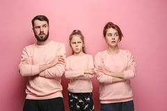 The sad family on pink Stock Image
