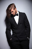 Sad fashion man in suit and tuxedo looking down Stock Image