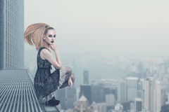 Sad fashion model on the rooftop Royalty Free Stock Image