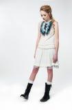 Sad fashion model woman standing. Studio shot Royalty Free Stock Photos