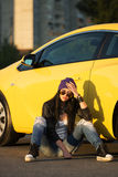 Sad fashionable woman sitting at the car Royalty Free Stock Images