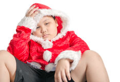Sad fat boy waiting for Christmas presents Stock Photography
