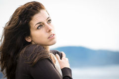 Sad feelings shivery woman. Woman feeling sad and shivering on fresh autumn day. Nostalgic and emotional natural female hugging herself and feeling low on cold Royalty Free Stock Image