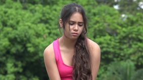 Sad female hispanic teen. A young female hispanic teen stock footage