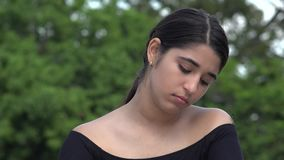 Sad Female Hispanic Teenager. A young female hispanic teen stock footage