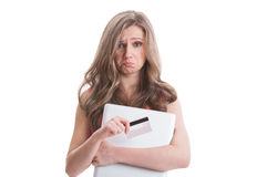 Sad female holding empty credit card Stock Image