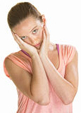 Sad Female Holding Her Face. Sad lady holding her face with her hands Royalty Free Stock Photos