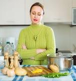 Sad female at kitchen Stock Photo