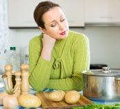Sad female at kitchen Stock Photography