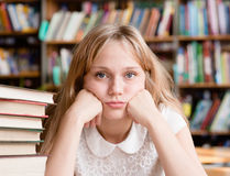 Sad female student in library looking at camera Stock Photography