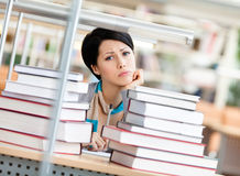 Sad female student over the books Royalty Free Stock Photos
