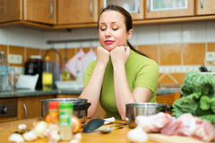 Sad female tired to cook Stock Image