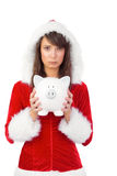 Sad festive woman holding a piggy bank in her hands Stock Image